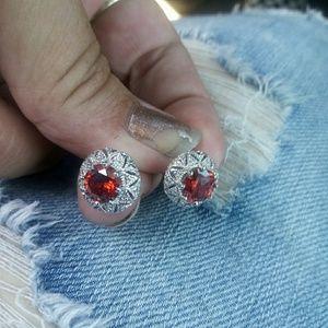 earrings with ruby like stone